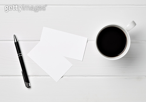 coffee cup note book table paper