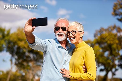 senior couple taking selfie happy elderly retired
