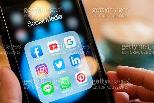 BANGKOK, THAILAND- 25 June 2019 : Hands of man use Iphone 7 plus with social media application of facebook, youtube, google search, instagram, twitter, linked in, line whatsapp, and pinterest