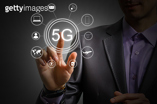 5g internet concept with businessman pressing buttons