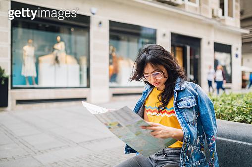 Chinese tourist woman holding map