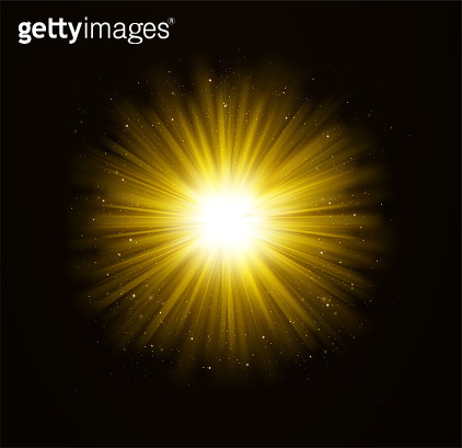Golden bright shining light effect with stars. Rays of light with sparkles on dark background.