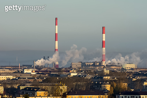 Landscape of smoking chimneys of factories in an industrial city.