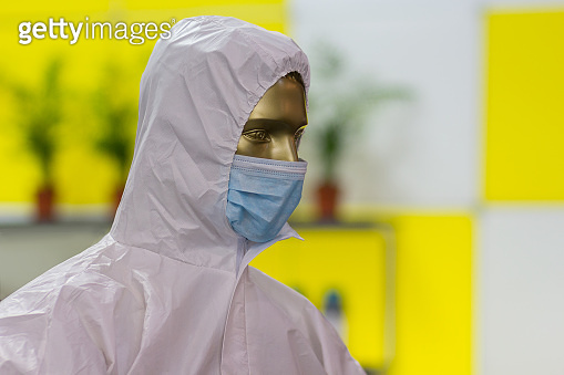 Mannequin with a protective mask and anti-chemical and antibacterial equipment. Medicine and Research