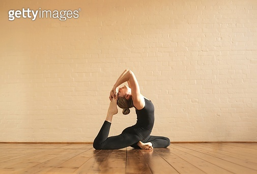 Girl practicing yoga positions