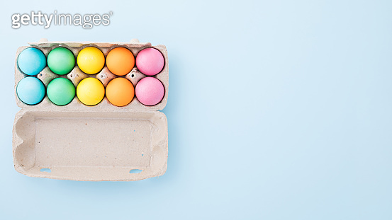 Multi-colored Easter eggs in factory biodegradable packaging