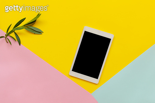 Digital Tablet on color block background