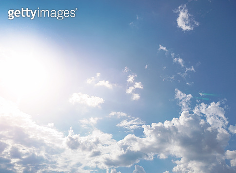 Beautiful sunny sky with white clouds. Natural background. Stock photo