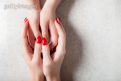 Mother is holding her kids hands, mothers day or relationship concept