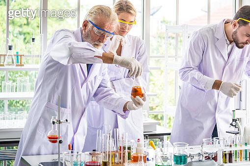 Scientists teamwork with senior brainstorming teaching science