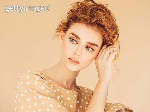 Studio shot of young beautiful girl