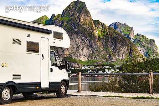 Camper car on fjord, Lofoten Norway