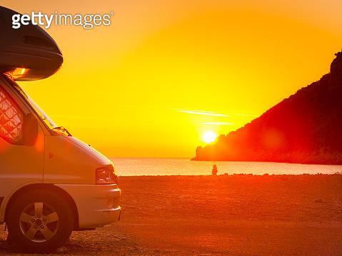 Camper car on nature at sunrise. Travel
