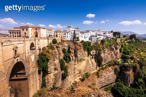Puente Nuevo stone bridge and Pueblos Blancos on edge of El Tajo Gorge in mountaintop town of Ronda in Spain