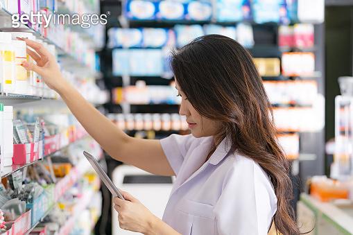 Asian female pharmacist in the pharmacy