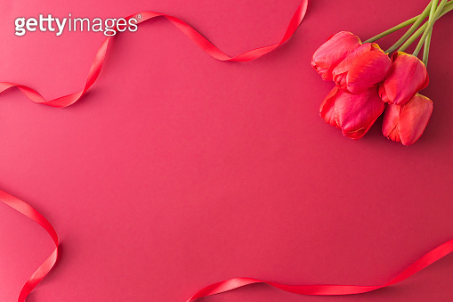 Floral frame with red tulips