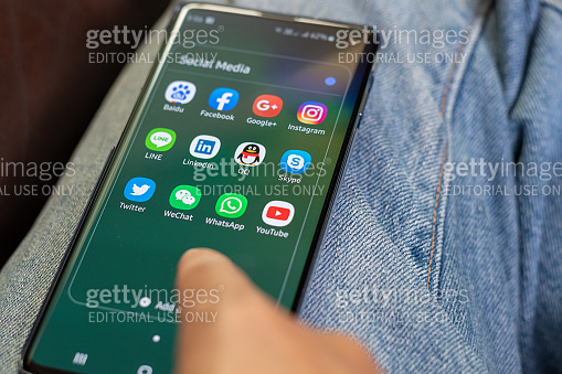 Lifestyle relaxing using smartphone with icons of social media on screen, smart phone life style, mobile phone era in everyday life
