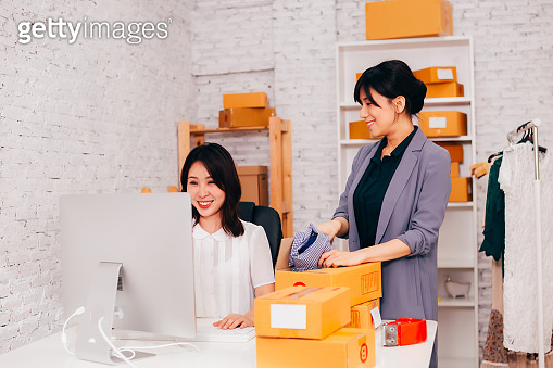 Happy Asian business women smiling in the office
