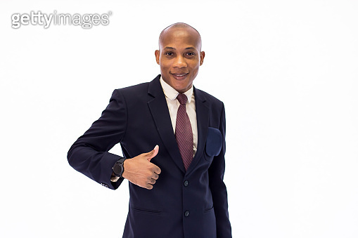 c1dc4a9d367 Attractive happy African American smiling professional businessman  executive giving thumbs up gesture isolated over white background
