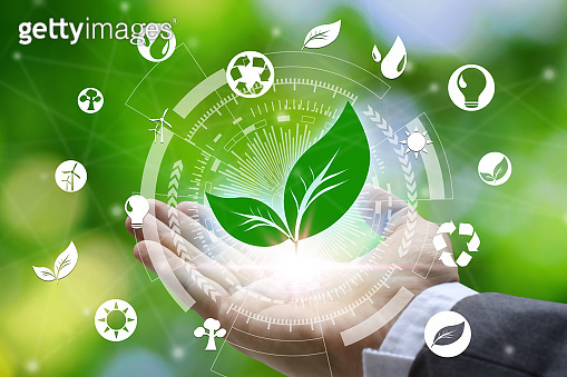 Hand holding with leaf and environment icons over the Network connection on nature background, Technology ecology concept. Environmental protection concept