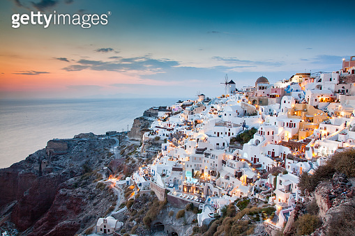 impressive evening view of Santorini island. Picturesque spring sunset on the famous Greek resort Oia, Greece, Europe. Traveling concept background.