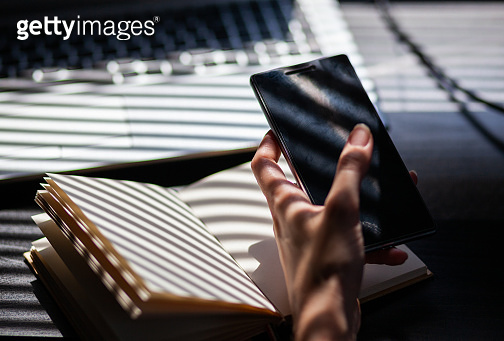 woman hands using smartphone, home office background, social media  influencer