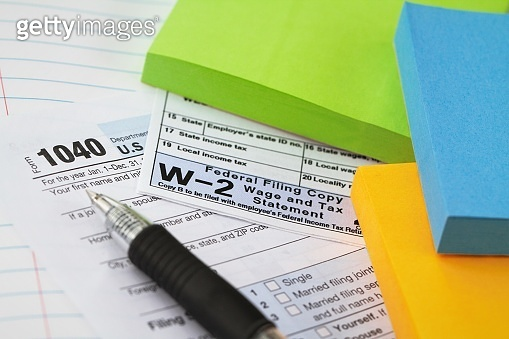 IRS 1040 tax form and w-2 wage statement: tax preparation concept.