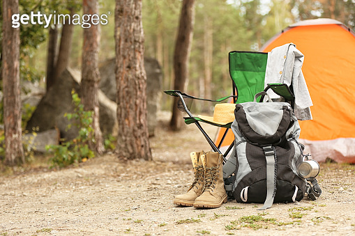 Set of camping equipment outdoors on summer day