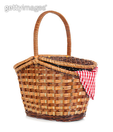 Wicker basket for picnic on white background