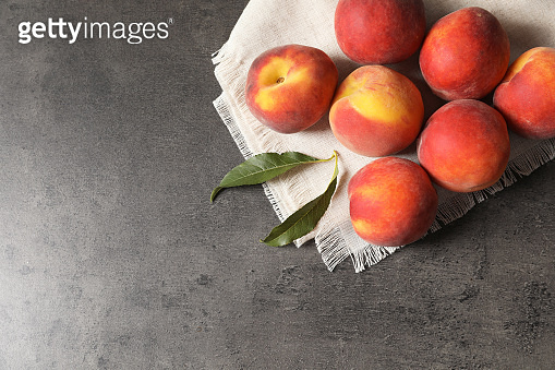 Fresh sweet peaches on table, top view