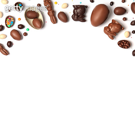 Flat lay composition with chocolate Easter eggs and space for text on white background