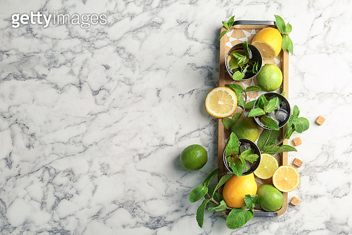 Flat lay composition with delicious mint julep cocktail on marble background
