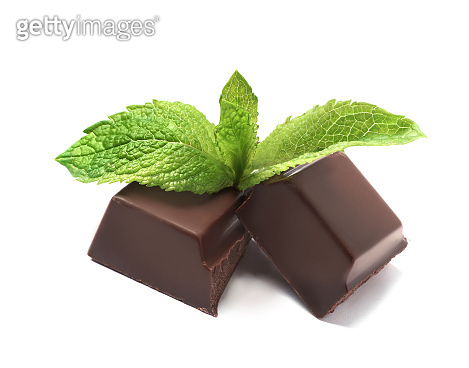 Pieces of dark chocolate with mint on white background