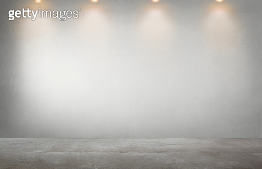 Gray wall with a row of spotlights in an empty room