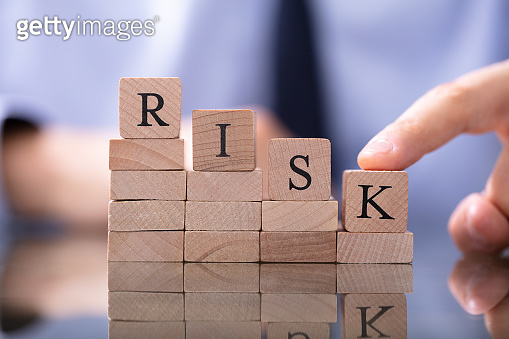 Risk Word With Declining Chart On Desk