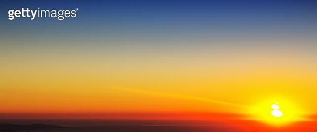Beautiful sunrise or sunset over the sea with dramatic multi-colored sky