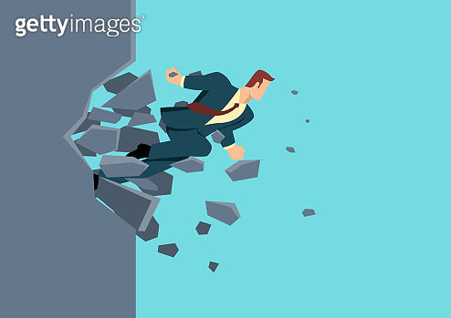Businessman breaking the wall