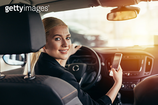 young businesswoman in car