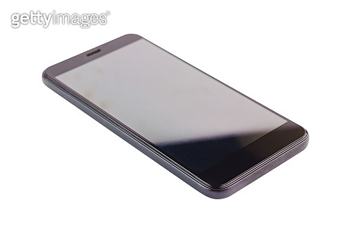 Single black smartphone with blank screen isolated on white background. Clipping path