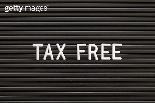 Black color felt letter board with white alphabet in word tax free background