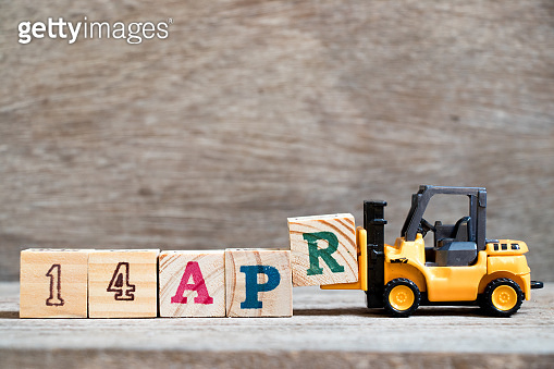 Toy forklift hold block R to complete word 14apr on wood background (Concept for calendar date 14 in month april)