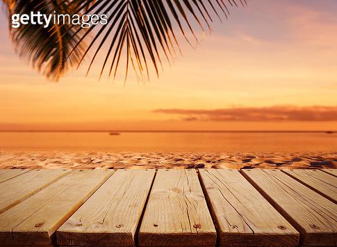 Wood plank on the sunset beach