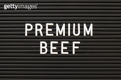 Black color felt letter board with white alphabet in word premium beef background