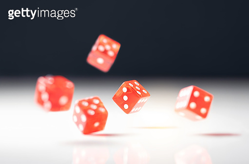 Roll the dice. Risk, luck, gambling, betting or addiction concept. Throwing five red casino and poker dice.