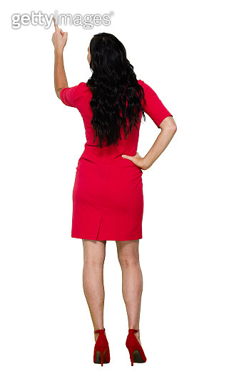 Full length / rear view / back / looking up / one person of adult beautiful black hair / long hair caucasian female / young women standing wearing dress and high heels / cool attitude who is pointing