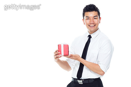 Handsome Asian Businessman - is holding gift box