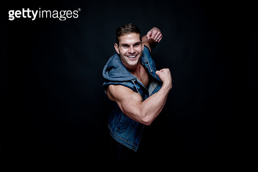 Sexy muscular man wearing a denim vest