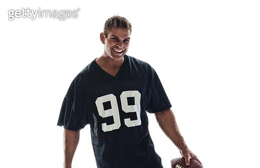 Handsome muscle guy sports fan