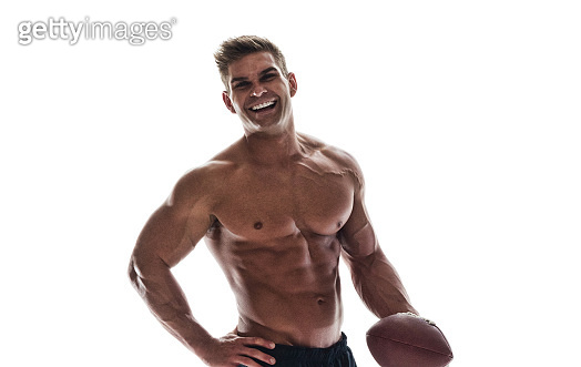 Handsome muscle guy holding American football
