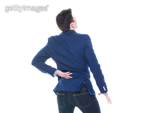 Rear view of businessman with backpain